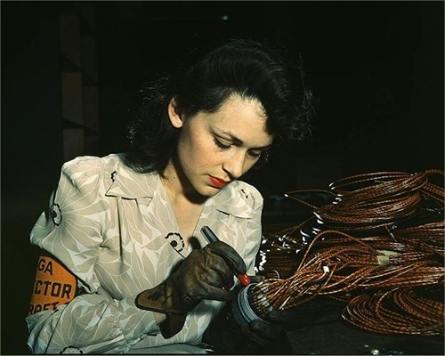 Woman aircraft worker Vega Aircraft Corporation Burbank Shown checking electrical assemblies 1942 June